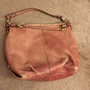 Pinkish coach purse with gold metal